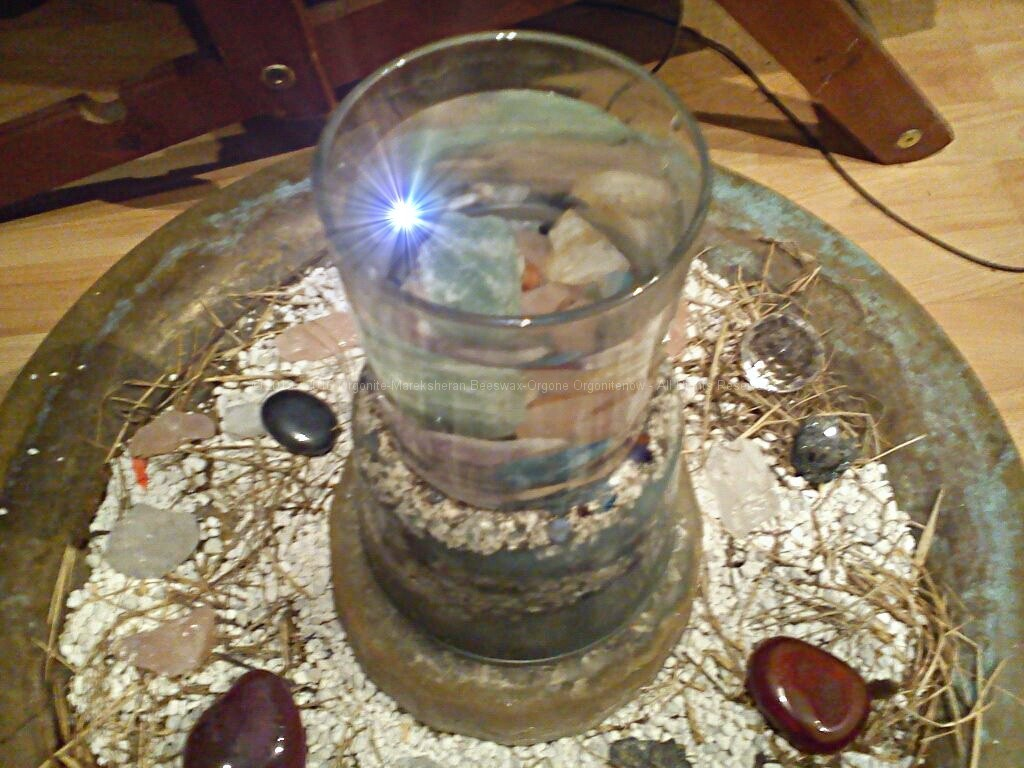 Glass of water with crystals to rest on beeswax orgonite (modifyed image)