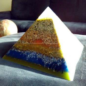 Ionio, 12 cm pyramid orgonite done with an opalite pyramid, blue apatite beeswax and metals, plus one piece of shungite under the pyramid.